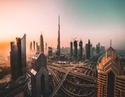 العرب اليوم - برج خليفة في دبي يتزيّن باللون الأخضر احتفاء باليوم الوطني السعودي